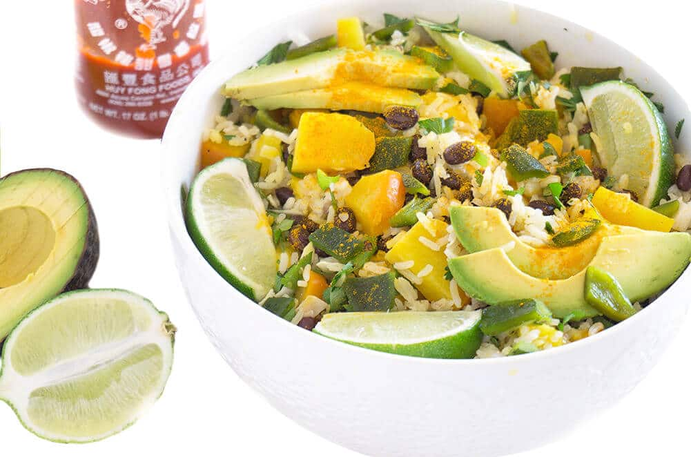 Tropical Black Bean and Rice Bowls has juicy mango, zesty lime, beans, golden beets + rice and gets spiced up with a few dashes of turmeric and sriracha | PLANT BASED | VEGAN | VEGETARIAN | HEALTHY FOOD IN BOWLS | Recipe at OatandSesame.com