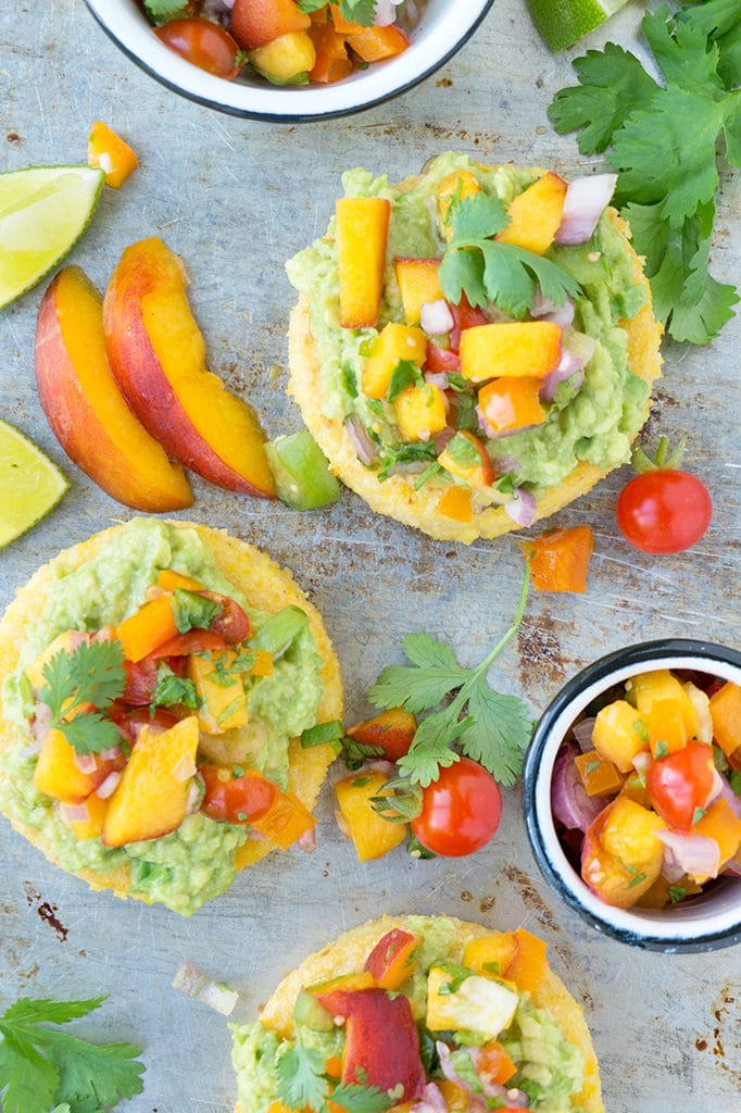 Peach Cilantro Salsa! When peaches are in season, it's time for peach salsa. Summer means corn, peaches, tomatoes, - everything I love! These easy polenta cakes are topped with Peach Cilantro Salsa. It's great in fish tacos, with a bag of chips or mixed with rice and beans! | VEGETARIAN | VEGAN | SALSA | SUMMER | recipe at OatandSesame.com