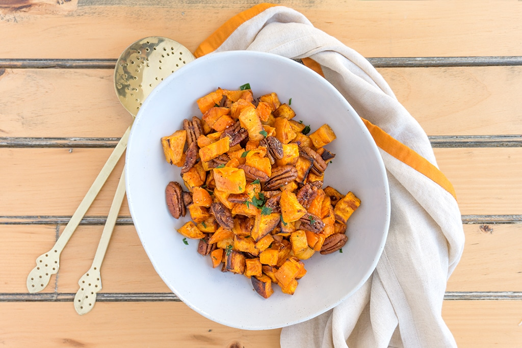 Roasted Sweet Potatoes with Apple Brandied Coconut Pecans - ramp up your Thanksgiving game | SWEET POTATOES | THANKSGIVING | CANDIED PECANS | Recipe at OatandSesame.com