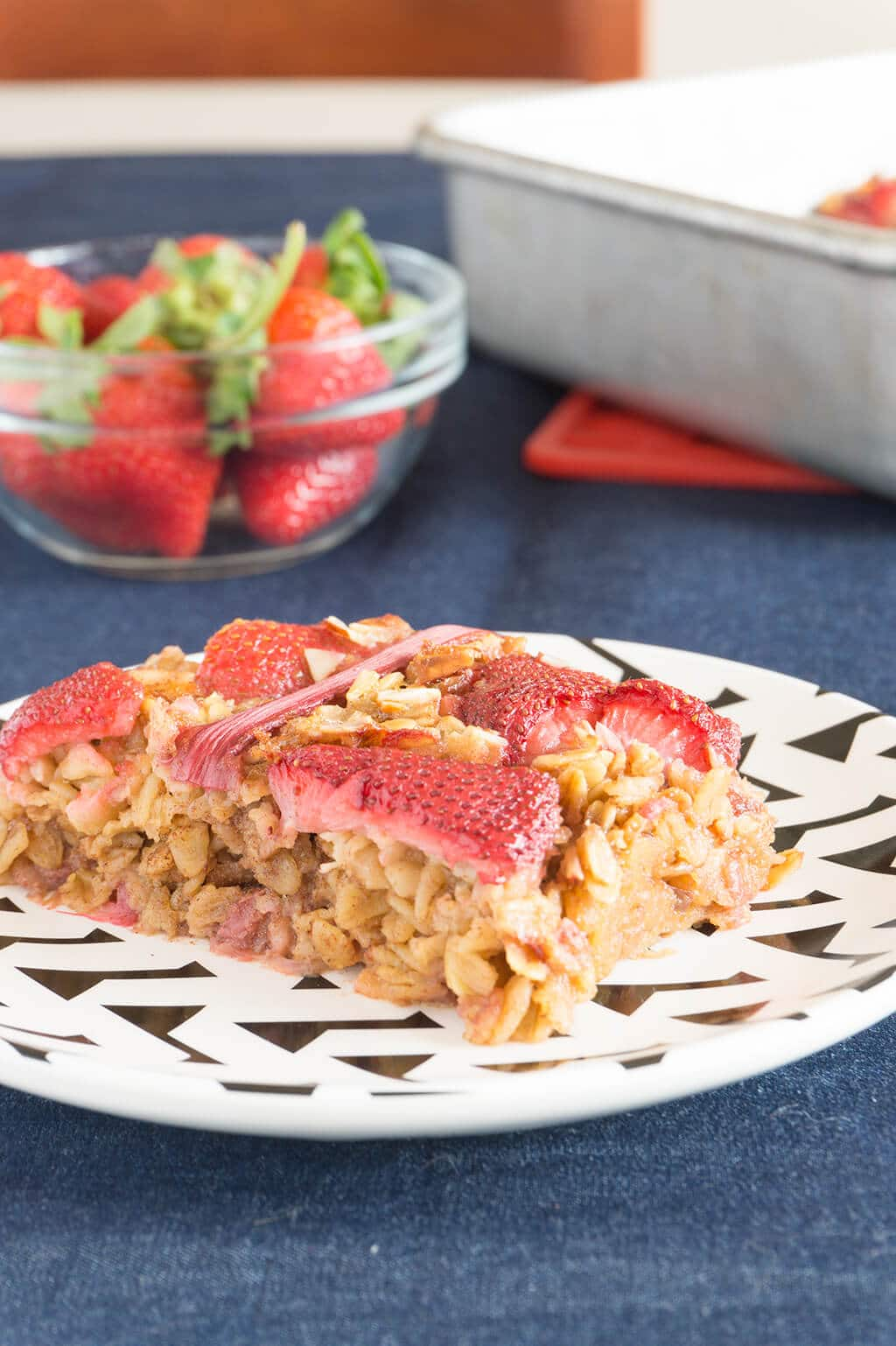 Strawberry Rhubarb Baked Oatmeal. Almonds, Fresh Rhubarb + Sweet Strawberries create a simple baked oatmeal. A great breakfast for the week ahead! | RHUBARB | STRAWBERRY | OATMEAL | BREAKFAST | GF | VEGAN | Recipe at OatandSesame.com