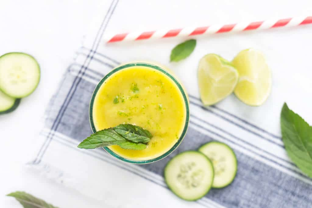 Cucumber water is SO refreshing. That is true for cucumber smoothies too! This Mango Cucumber Mint Smoothie is light and refreshing and perfectly sweet without the addition of sweeteners. It's what a healthy smoothie should be! | SMOOTHIES | CUCUMBER | MANGO | VEGAN | Recipe at OatandSesame.com