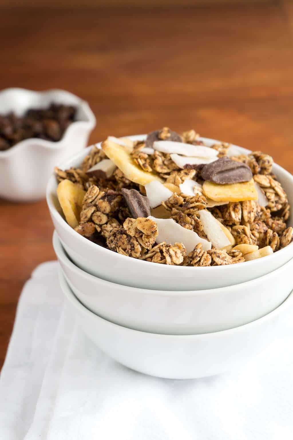 Chunks of semi-sweet chocolate, coconut and banana chips mixed into a toasted Georgia Pecan Coffee Granola for a scrumptious breakfast or snack! | BREAKFAST | GRANOLA | COFFEE | VEGAN | GLUTEN FREE | Recipe at OatandSesame.com