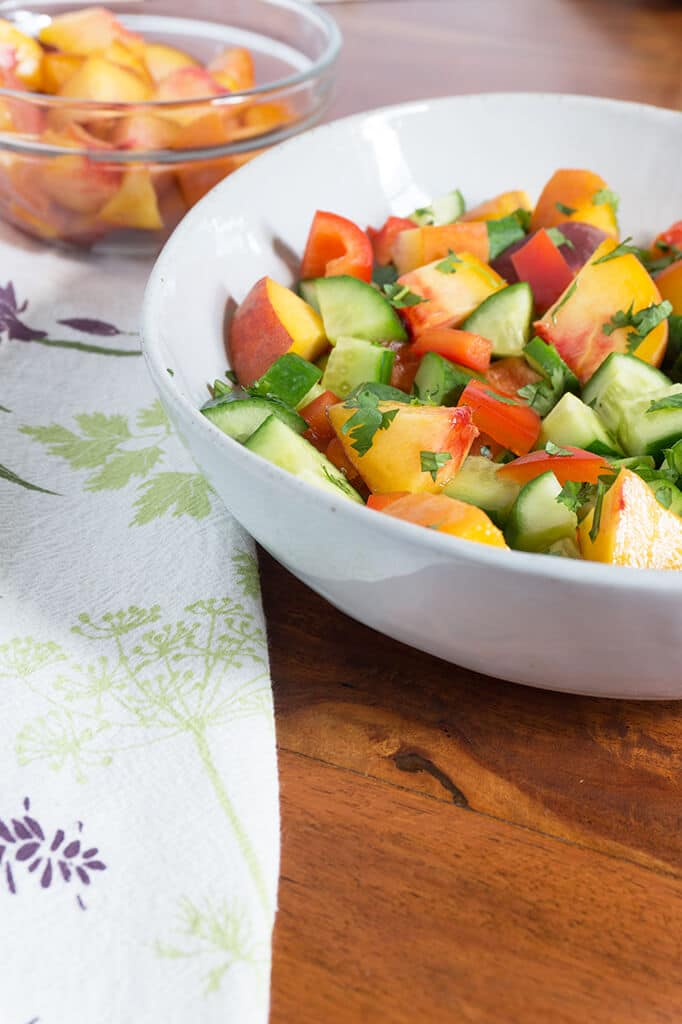 This Sweet Peach Cucumber Salad incorporates all the wonderful produce from your local farmer's market! Fresh cucumbers, red peppers, peaches and fresh herbs! Summer flavors that speak for themselves without any fuss. | GLUTEN FREE | VEGETARIAN | VEGAN | PLANT BASED | PEACHES | SALAD | HEALTHY | Recipe at OatandSesame.com
