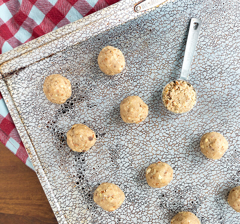 Maple Pecan Tea Cookies are infused with maple extract and loads of chopped pecans. Crescent shaped or in ball form, these cookies have just a touch of sweetnesswith a light + buttery texture just like a traditional tea cookie should be!   COOKIES   BAKING   PECAN   HOLIDAY   Recipe at OatandSesame.com